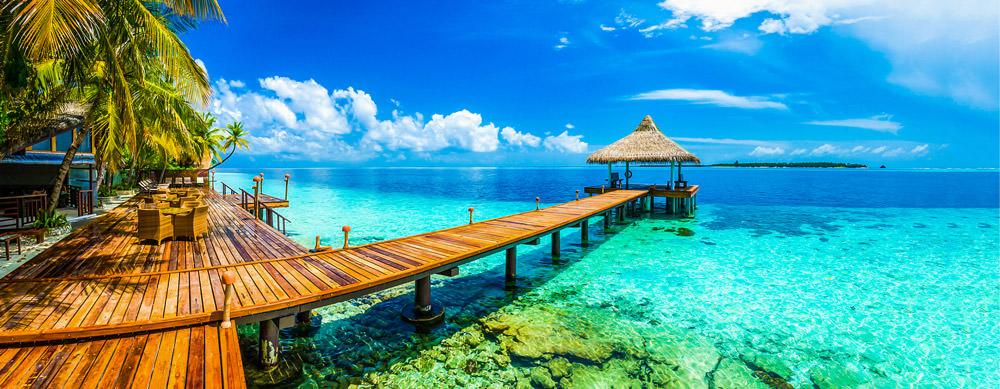 Maldivas tiene de todo para explorar. Asegúrate de ir en forma segura con tus vacunas de viaje y los consejos de Passport Health.