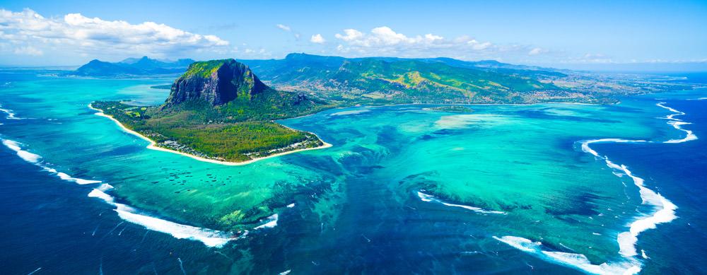 Mauricio tiene de todo para explorar. Asegúrate de ir en forma segura con tus vacunas de viaje y los consejos de Passport Health.